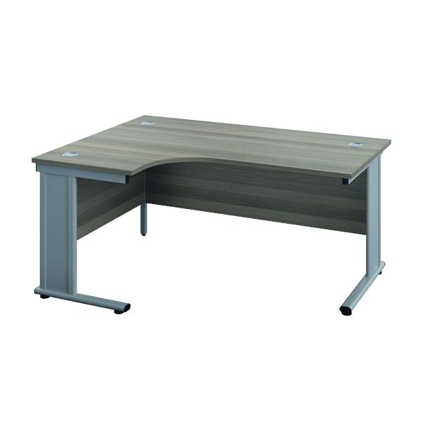 Jemini Double Upright Metal Insert Left Hand Wave Desk 1800x1200mm Grey Oak/Silver