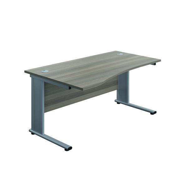 Jemini Double Upright Metal Insert Left Hand Wave Desk 1600x1000mm Grey Oak/Silver